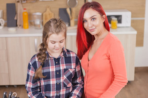 Beautiful mother and daughter cooking together. Family time