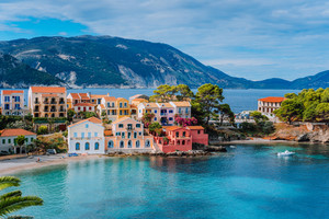 Beautiful panoramic view of Assos village with vivid colorful houses near blue turquoise colored and transparent bay lagoon. Kefalonia, Greece