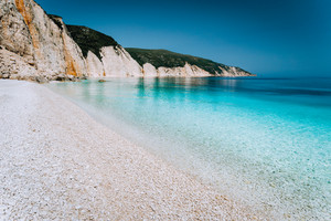 Beautiful pebble stone beach. Summer holiday and vacation concept for tourism. Inspirational mediterranean landscape