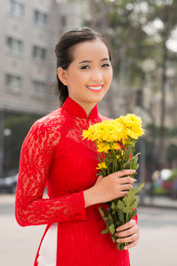Beautiful Vietnamese woman with flowers