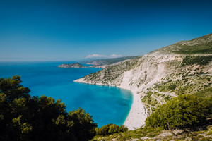 Beautiful view of Myrtos beach in high tourist summer season. Myrtos is one of the famous beaches in the world and the Mediterranean sea located in Kefalonia island, Greece, Europe