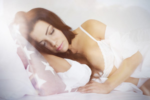 Beautiful woman sleeping in the bed