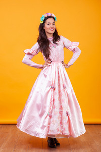 Beautiful young woman wearing fairy pink dress. Faiy tale