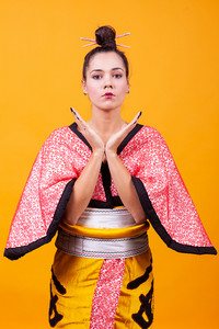 Beautiful young woman wearing japanese costume. Geisha girl