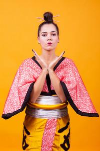 Beautiful young woman wearing japanese costume. Geisha girl