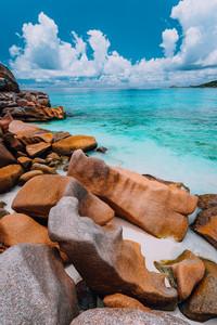 Beautifully shaped granite boulders in evening light at Grand Anse beach, La Digue island, Seychelles