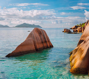 Beautifully shaped granite boulders in evening sunset light at Anse Source d'Argent beach, La Digue island, Seychelles