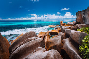 Beautifully shaped granite boulders on Grand Anse beach, La Digue island, Seychelles