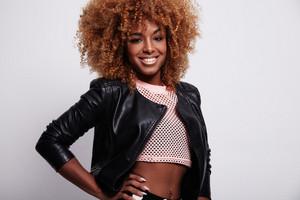 beauty black blonde woman in leather jacket