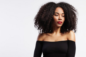 beauty black woman portrit with curly hair