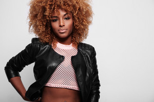 beauty black woman with big afro blonde hair wears leather jacke