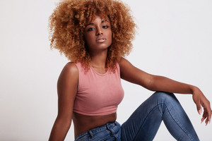 beauty black woman with big afro hair in studio shoot