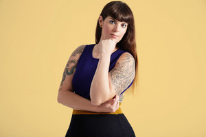 beauty plus size woman with tatooed arms and omre hair portrait