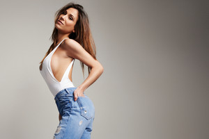 beauty spanish woman in jeans with long straight hair