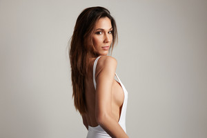 beauty spanish woman in studio shoot in grey