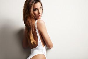 beauty spanish woman in swimsuit in studio