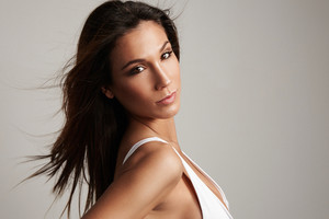 beauty spanish woman with long straight hair watching at camera. ideal skin