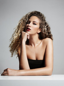 beauty woman with a curly hair and bright lips