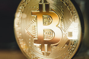 Beijing, China - December 29, 2017: Two months after the closure of Chinese exchanges, Bitcoin price broke $11000 in December 2, 2017, and some new forks of Bitcoin were launched