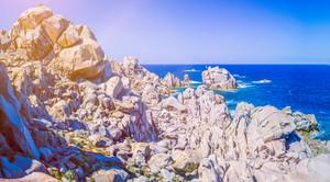 Bizarre granite rock formations under sun light. Capo Testa, Sardinia, Italy