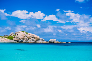 Bizarre granite rocks formation in amazing azure water on beautiful Sardinia island near Porto Pollo, Sargedna, Italy