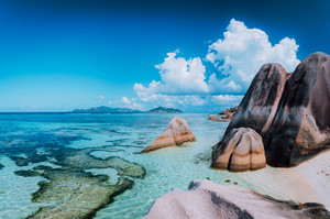 Bizarre huge granite rocks boulders at the famoust Anse Source d'Argent beach on island La Digue in Seychelles. Exotic paradise scenery concept