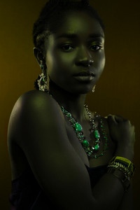 Black Beautiful Woman Wearing Jewelry Over Brown Background