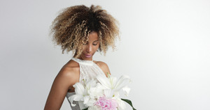 black mixed race bride with flowers