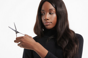 black woman hold scissors for haircut