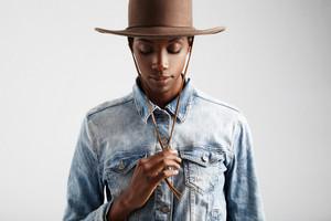 black woman in cowboy hat