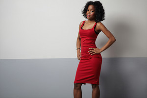 black woman in red dress showing beauty body