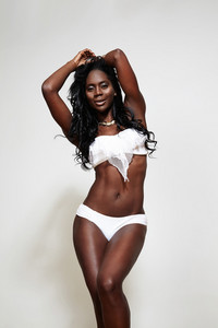 black woman in swimsuit with ideal body