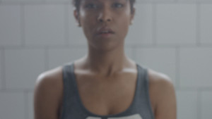 black woman portrait during weight training closeup with foucus on hand with weight moving to a camera Portrait out of focus
