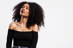 black woman wears bright glossy red lipstick