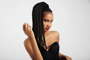 black woman with african braids. natural hair