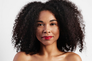 black woman with big afro hair portrait