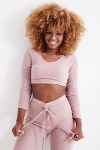 black woman with blonde curly hair in studio shoot