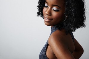 black woman with closed eyes, shows silver eyeshadows
