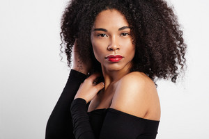 black woman with curly hair and bright red lips
