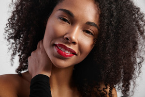 black woman with curly hair closeup portrait