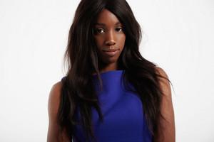 black woman with long straight wavy haircut