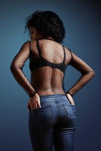 black woman's back, wears jeans