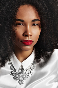 black woman's closeup portrait. ideal skin red glossy lips