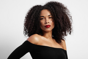 black woman's portrait with ideal glossy red lips