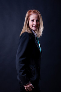 Blonde woman in business suit on blackground. Right choice.