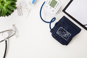 Blood Pressure Machine With Stethoscope And Clipboard On White T