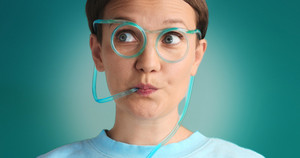 blue eyed woman drinking lemonade using drinking straw glasses