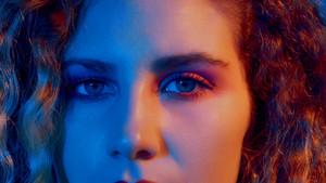 blue red light portrait eyes closeup
