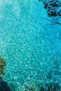 Blue turquoise ripple water in mediterrean bay. The crystal clear sea and sun. Swimming summer time