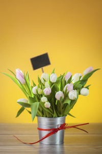 Bouquet of tulips in rustical pot